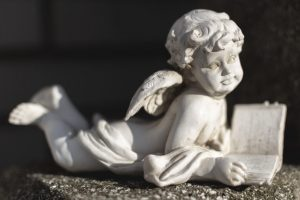 Statue-of-an-Angel-on-a-Grave-300x200